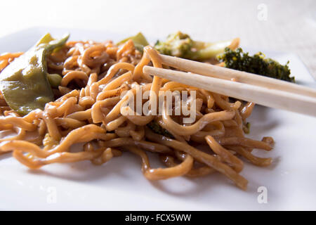 Chinese noodles vegetables and chopsticks - Stock Photo