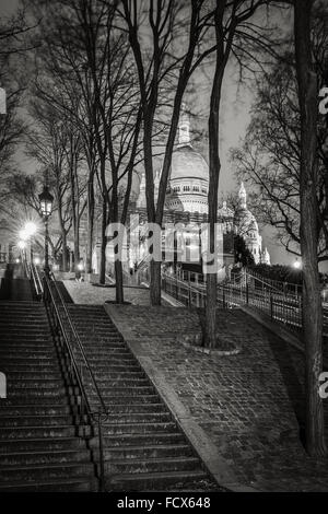 Stairs leading to the Basilica of the Sacred Heart (Sacre Coeur Basilica) at night in Montmartre - Black and White, - Stock Photo
