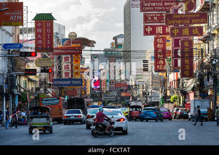Yaowarat Road in Chinatown, people and cars, commercial street, billboards, neon signs, Bangkok, Thailand - Stock Photo