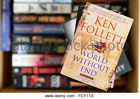 Ken Follett 2007 novel World Without End, stacked used books, England - Stock Photo