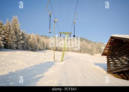 Traditional ski lift with slope im Pitztal, Austria, European Alps - Stock Photo
