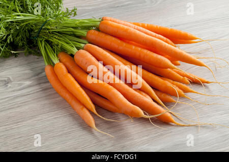 Fresh bunch of orange carrots - Stock Photo