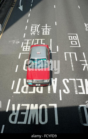 Red Hong Kong taxi seen from above in the Central district of Hong Kong Island - Stock Photo