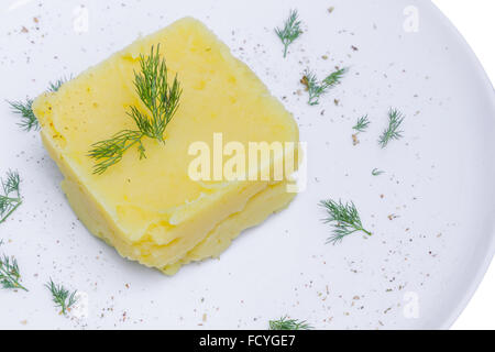 Mashed potatoes with dill in white plate - Stock Photo