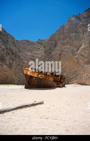 Shipwreck on Navagio beach on the island of Zakynthos, in Greece - Stock Photo