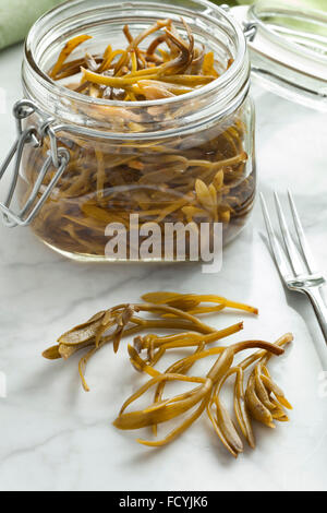 Pickled samphire in a glass jar - Stock Photo