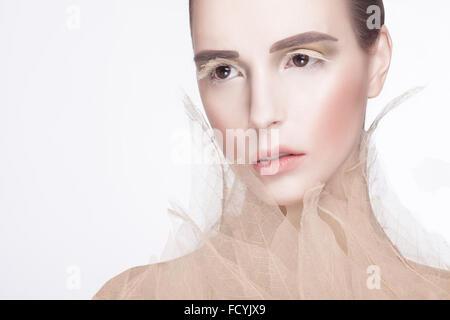 Model posing with skeleton leaves - Stock Photo