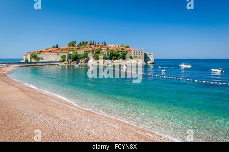 Sveti Stefan island and paradise beach in Montenegro - Stock Photo