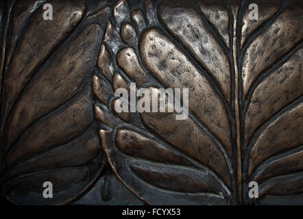Big leaves bronze relief background - Stock Photo