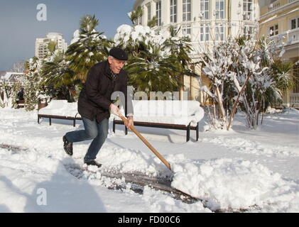 Sochi, Russia. 26th Jan, 2016. A man clearing snow after a heavy snowfall. Credit:  Artur Lebedev/TASS/Alamy Live - Stock Photo
