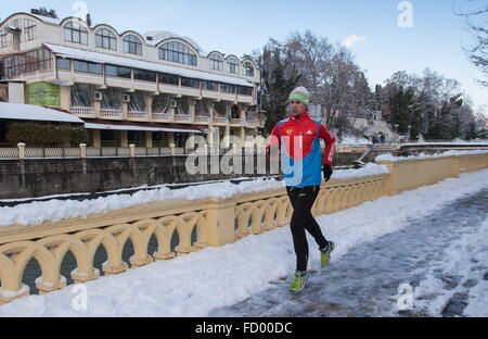 Sochi, Russia. 26th Jan, 2016. A man jogging after a heavy snowfall. Credit:  Artur Lebedev/TASS/Alamy Live News - Stock Photo