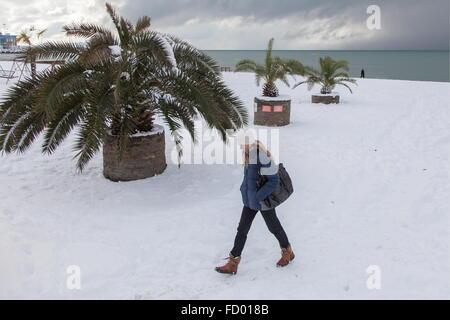 Sochi, Russia. 26th Jan, 2016. A woman walking by the Black Sea coast after a heavy snowfall. Credit:  Artur Lebedev/TASS/Alamy - Stock Photo