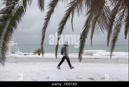 Sochi, Russia. 26th Jan, 2016. A man walking by the Black Sea coast after a heavy snowfall. Credit:  Artur Lebedev/TASS/Alamy - Stock Photo