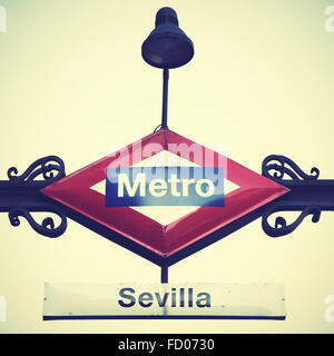 Metro sign in Madrid, Seville station. Vintage style filtred image - Stock Photo