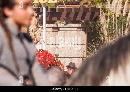 Horsemen riding through the crowd at the end of the San Sebastian fiesta Costa Adeje Tenerife - Stock Photo