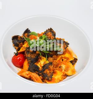 closeup of juicy pasta and tomato sauce - Stock Photo