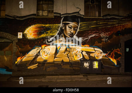 Urban street art at night in Stokes Croft, Bristol, England - Stock Photo