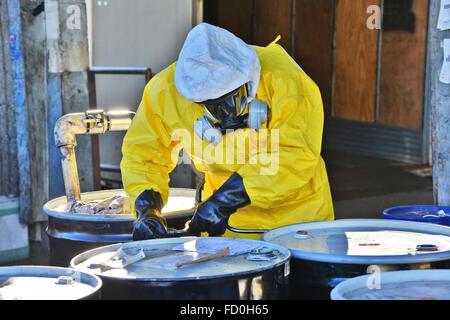 Toxic waste disposal, hazardous material handling - Stock Photo
