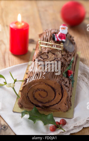yule log cake, traditional of christmas time dough with  coffe - Stock Photo