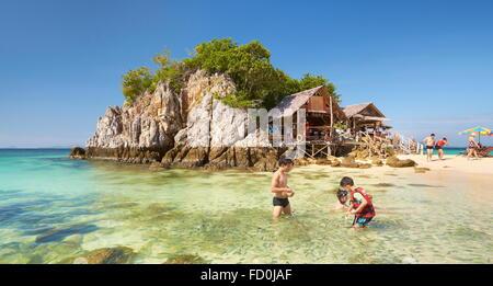 Thailand - tropical Khai Island, Phang Nga Bay, turists feeding fish in the shallow water - Stock Photo