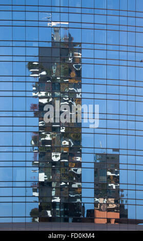 Reflection of the Bosco Verticale (Vertical Forest) residential towers in the Porta Nuova district in Milan, Lombardy, - Stock Photo