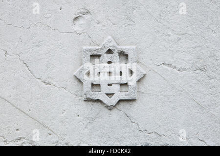 Decorative marble rosette at the Cimitero Monumentale (Monumental Cemetery) in Milan, Lombardy, Italy. - Stock Photo