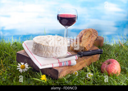 NormandyCheese, wine and bread, French culinary Scene - Stock Photo