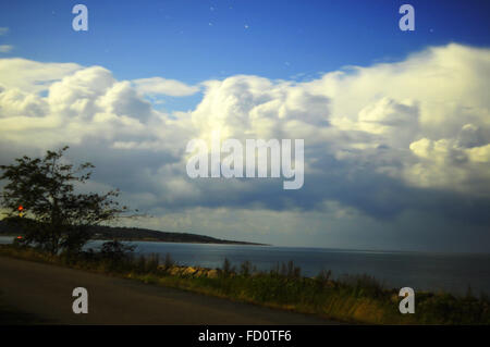 Night sky in Sweden by the sea, clouds photographed with long exposure. - Stock Photo