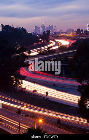 The 10 and 710 Freeway interchange seen from an aerial view and in the distance the Los Angeles skyline.  Los Angeles, - Stock Photo