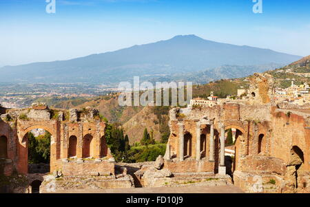 The Greek theatre in Taormina, Mount Etna Volcano in the distance, Sicily, Italy - Stock Photo