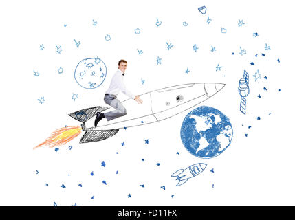 Young businessman flying in sky on drawn rocket - Stock Photo