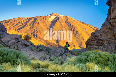 Tourist in Teide National Park, Tenerife, Canary Islands, Spain - Stock Photo