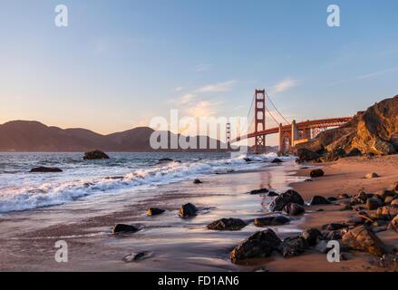 Golden Gate Bridge, Marshall's Beach, rocky coast, San Francisco, USA - Stock Photo