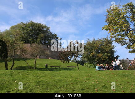 People pick-nicking on Burcht Hill park, a medieval 11th century stronghold in the old city centre of Leiden,  Netherlands - Stock Photo