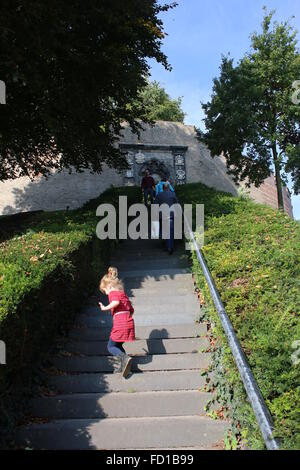 Girl playing on stairway leading up to Burcht Hill, a medieval 11th century stronghold in medieval centre of Leiden, - Stock Photo