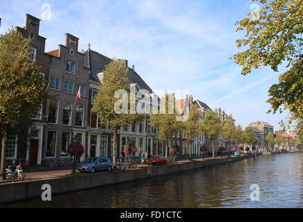 Historic old mansions along tree-lined Rapenburg main canal in Leiden, The Netherlands - Stock Photo
