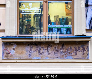 Berlin Fahrrad station bicycle shop with old preserved 'ghost sign' from previous business - Stock Photo