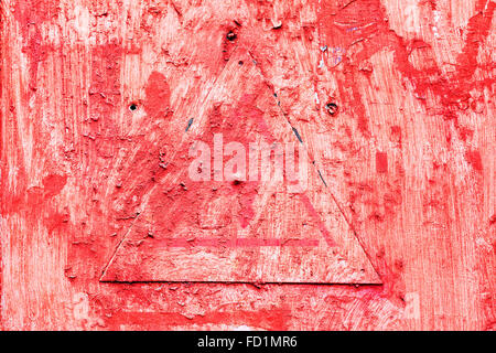 Creative background metal triangle cracks and scratches carelessly painted with red paint. Textured background for - Stock Photo