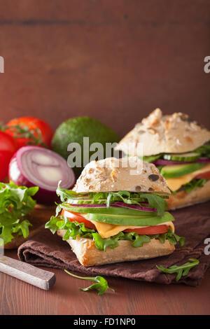 vegetarian sandwich with tomato, avocado and fresh arugula ...