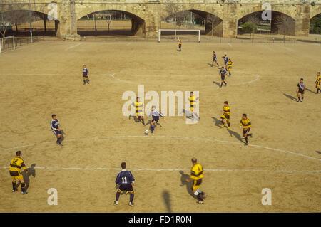 Football game, in Jardi (Garden) del Turia,Valencia,Spain - Stock Photo