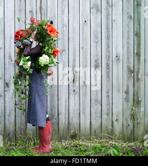 girl with red and green flowers - Stock Photo