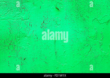 Bright abstract background old metal surface sloppy paint green paint with highlights, streaks, scratches and cracks