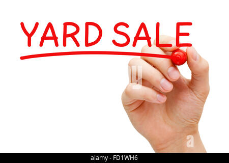Hand writing Yard Sale with red marker on transparent wipe board. - Stock Photo