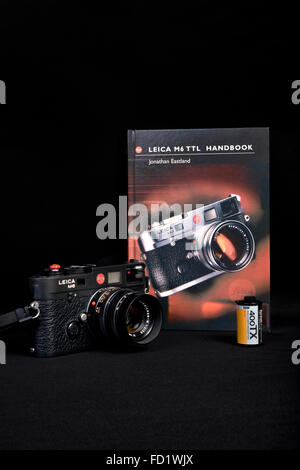Leica M6 TTL classic 35mm vintage rangefinder film camera and handbook. - Stock Photo