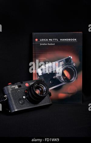 Leica M6 TTL 35mm vintage rangefinder film camera and handbook. - Stock Photo