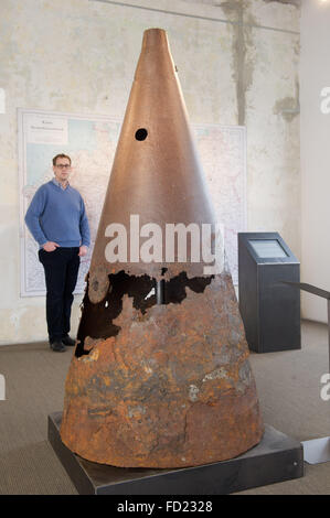 Philipp Aumann, exhibition curator of the Peenemuende Historical Technical Museum is standing behind a tip of a - Stock Photo