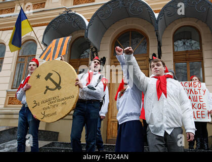 Kiev, Ukraine. 27th Jan, 2016. Ukrainian activists dressed in uniforms of Soviet pioneers stand with a big symbolic - Stock Photo