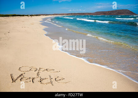 Horizontal view of Cape Verde written in the sand at Kite Beach. - Stock Photo