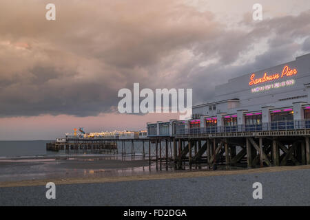 Storm clouds gathering over the pier at Sandown on the Isle of Wight - Stock Photo