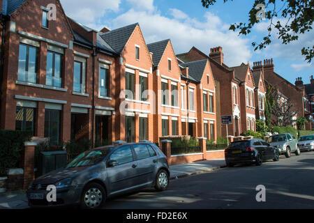 New houses at Calais Street, Myatts Field Park, Brixton, Lambeth, London – red brick terraced houses - Stock Photo